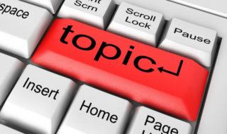 topic word on white keyboard