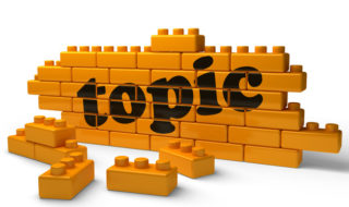 topic word on yellow brick wall