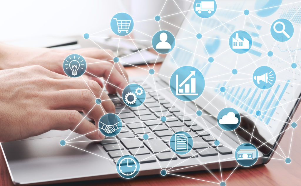 Businessman using laptop for analyzing data. Enterprise resource planning concept.  Business structure and many business icons.